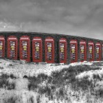 Multiple copies of the gallery line up to support the arches of the iconic Ribblehead viaduct in this exhibit.